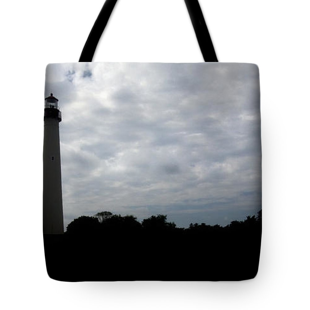 Lighthouse Tote Bag featuring the photograph Lighthouse In Silhouette by John Hoesly