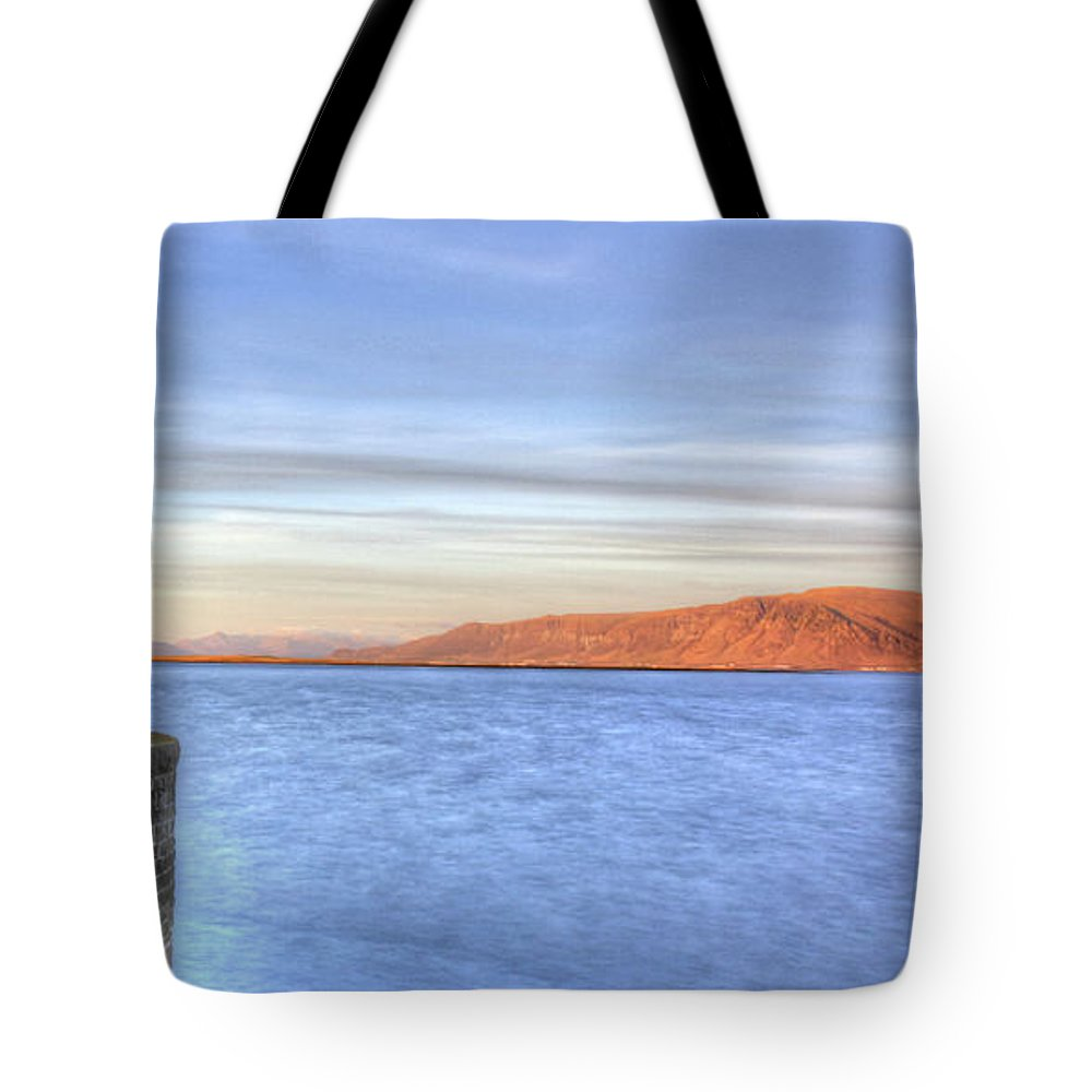 Iceland Tote Bag featuring the photograph Lighthouse Of Reykjavik by Mike Cameron