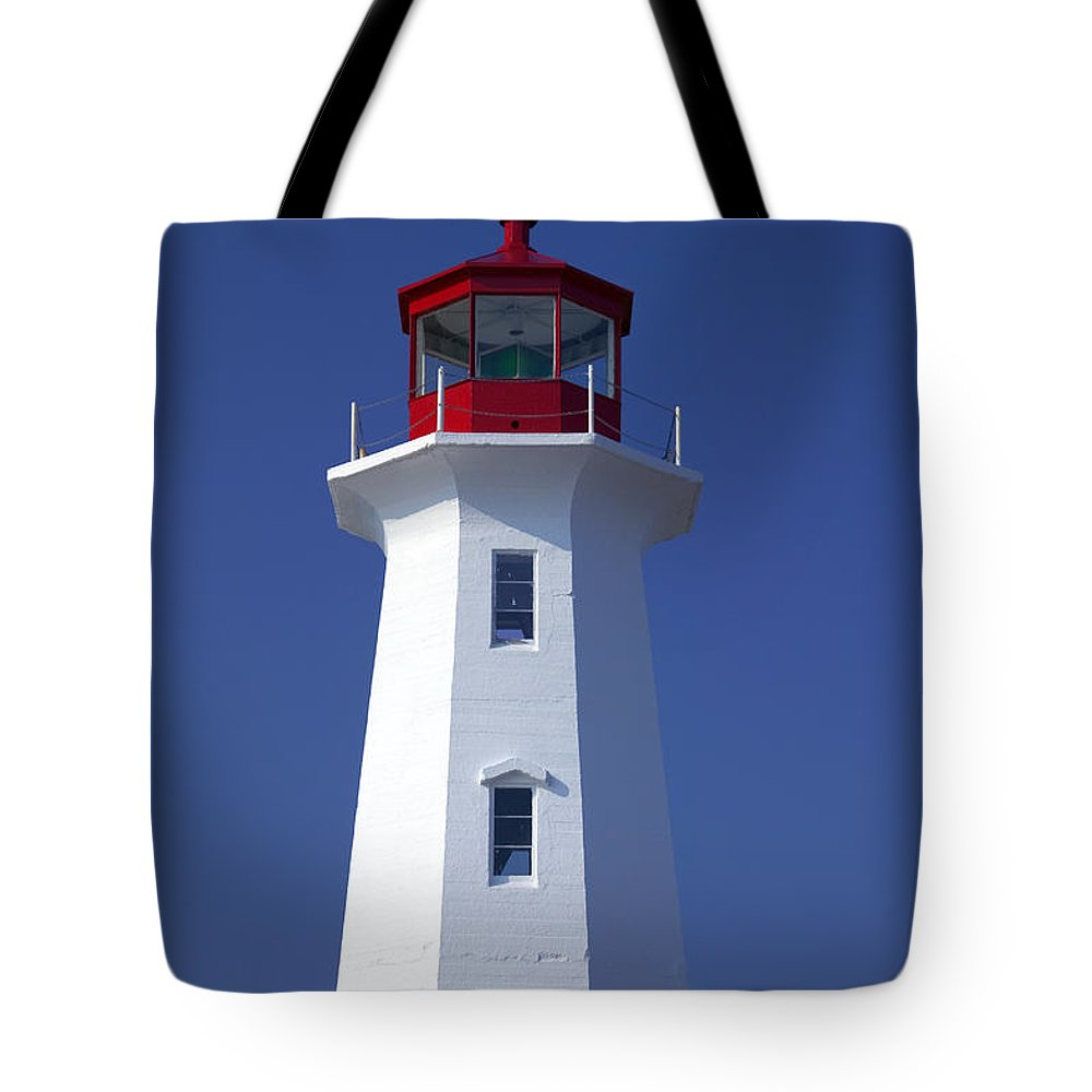 Lighthouse Tote Bag featuring the photograph Lighthouse Peggy's Cove by Garry Gay