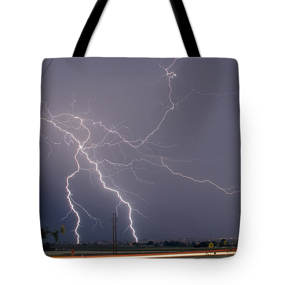 Lightning Tote Bag featuring the photograph Lightning Storm Power Lines Car Trails by James BO Insogna