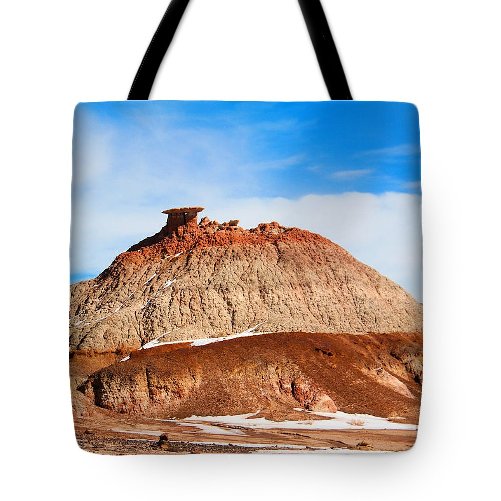 Badlands Tote Bag featuring the photograph Like A Mound Of Prehistoric Mud by Jeff Swan