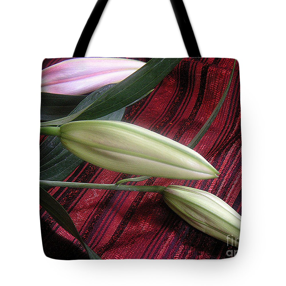 Nature Tote Bag featuring the photograph Lily Stem On Red Brocade by Lucyna A M Green