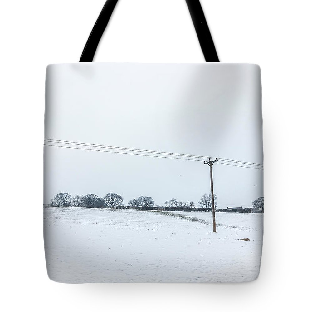 Copy Space Tote Bag featuring the photograph Line Across The Snow by Raelene Goddard