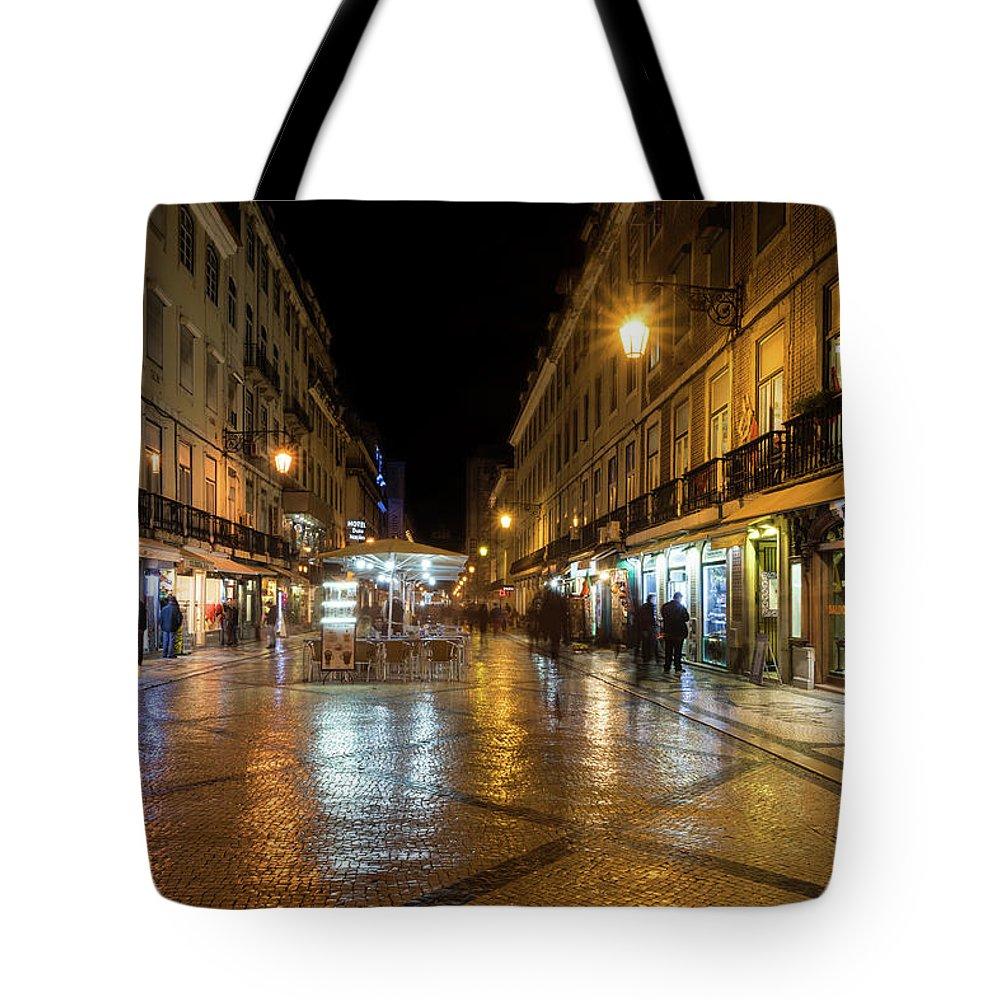 Georgia Mizuleva Tote Bag featuring the photograph Lisbon Portugal Night Magic - Nighttime Shopping In Baixa Pombalina by Georgia Mizuleva
