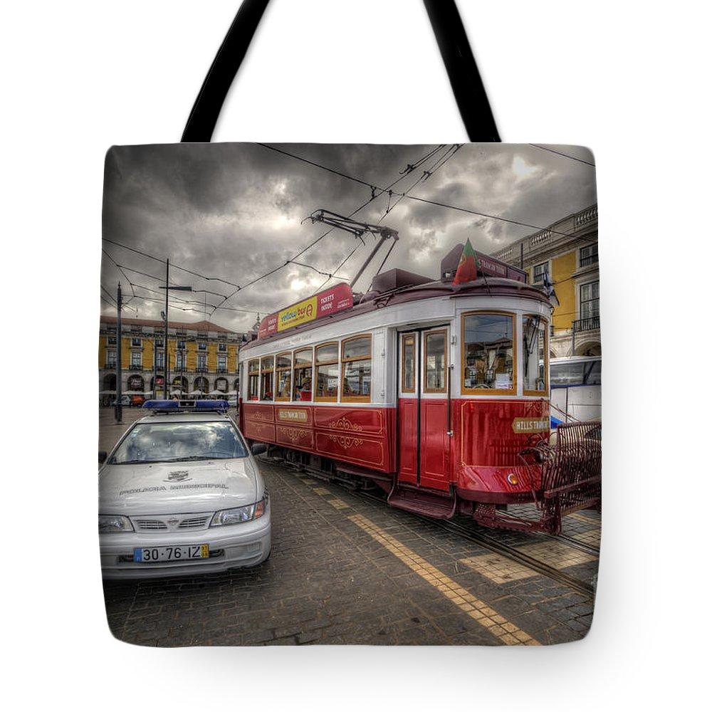 Yhun Suarez Tote Bag featuring the photograph Lisbon Tram by Yhun Suarez