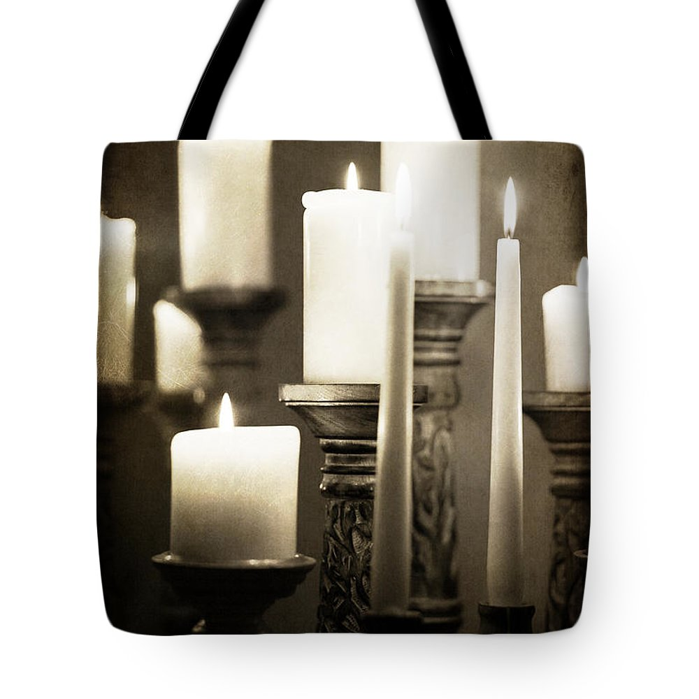 Atmospheric Tote Bag featuring the photograph Lit Church Candles by Jacqui Hall