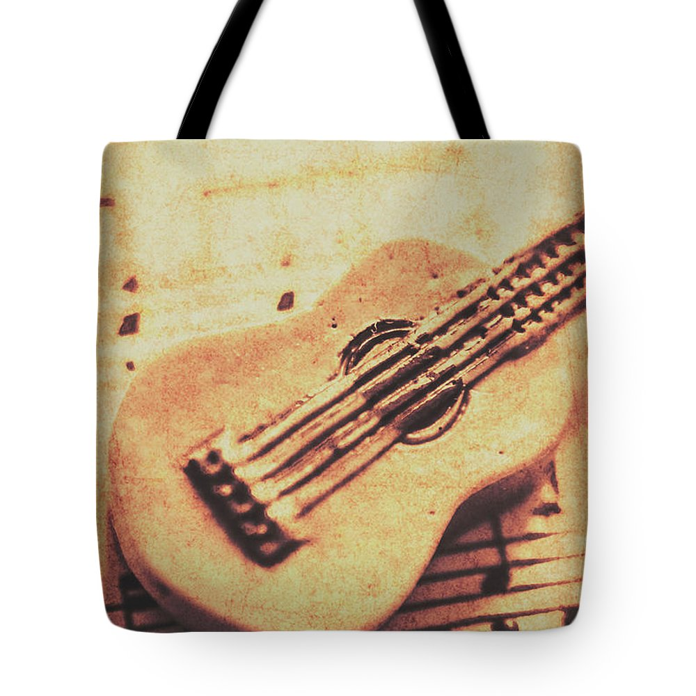 Little Carved Guitar On Sheet Music Tote Bag for Sale by Jorgo ...