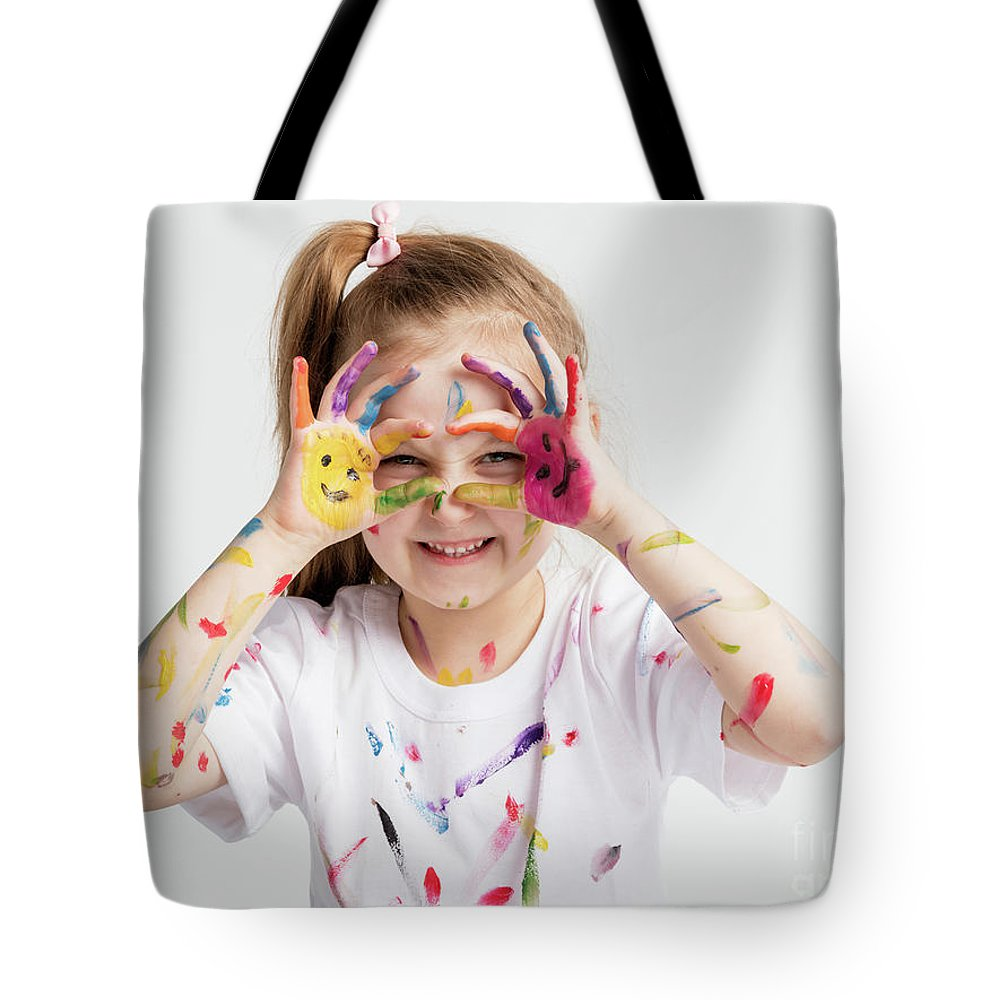 Girl Tote Bag featuring the photograph Little Girl Covered In Paint Making Funny Faces. by Michal Bednarek