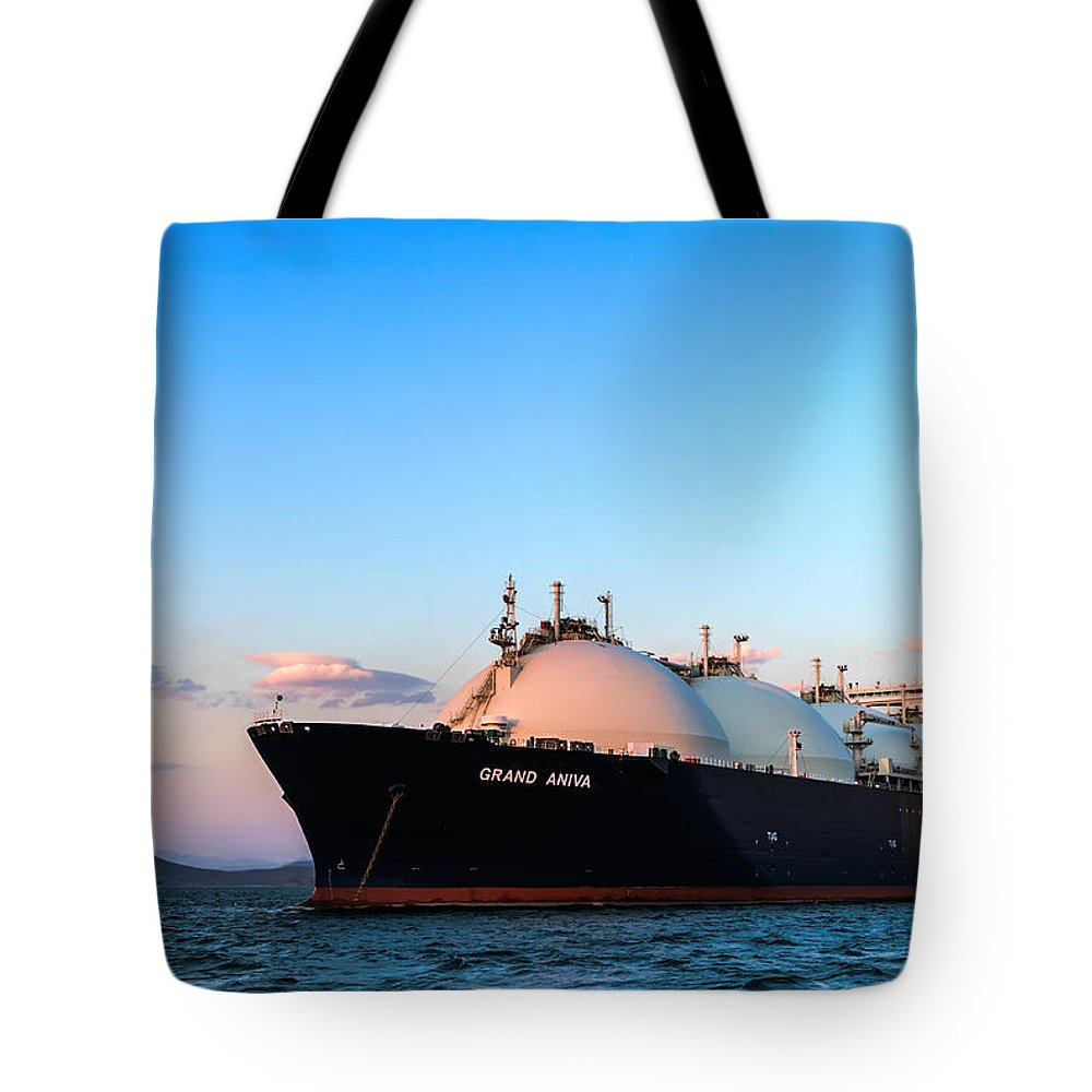Boat Tote Bag featuring the photograph Lng Carrier Grand Aniva At Sunset On The Roads Of The Port Of Nakhodka. by Vladimir Serebryanskiy