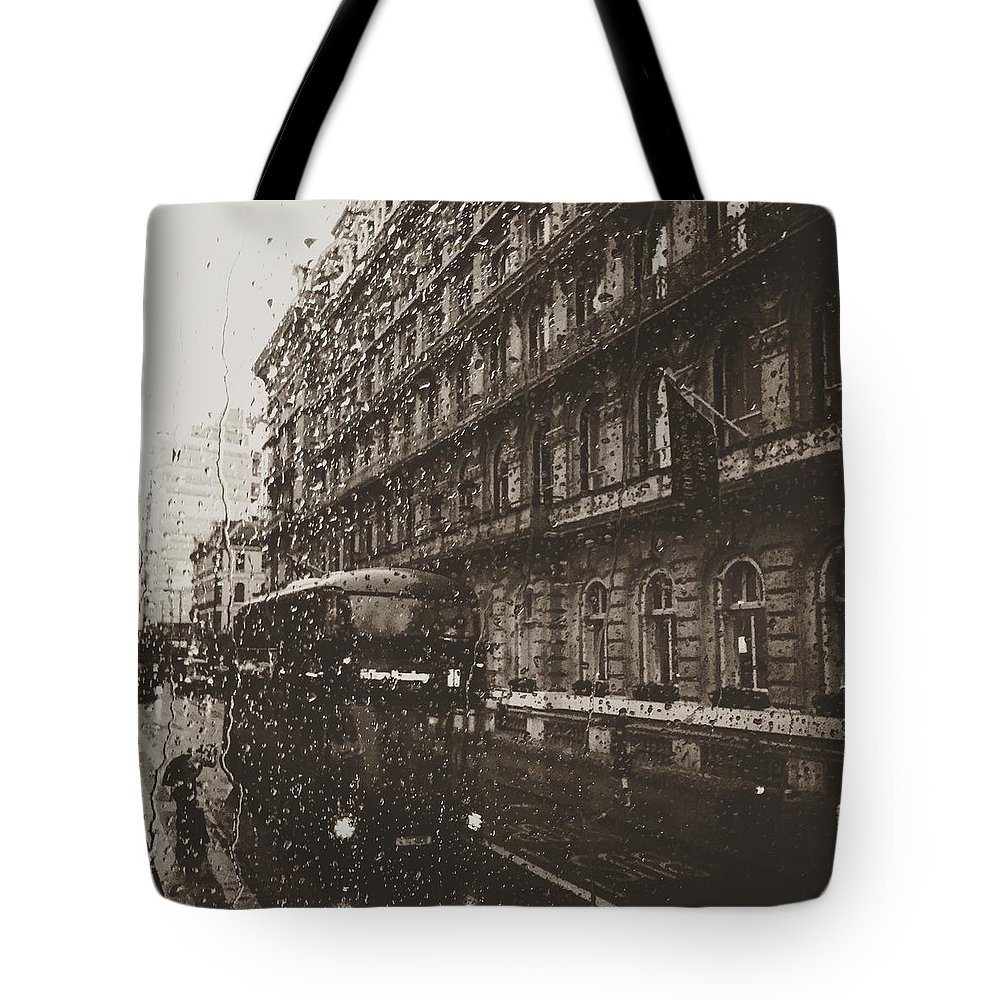 Rain Tote Bag featuring the photograph London rain by Trystan Oldfield