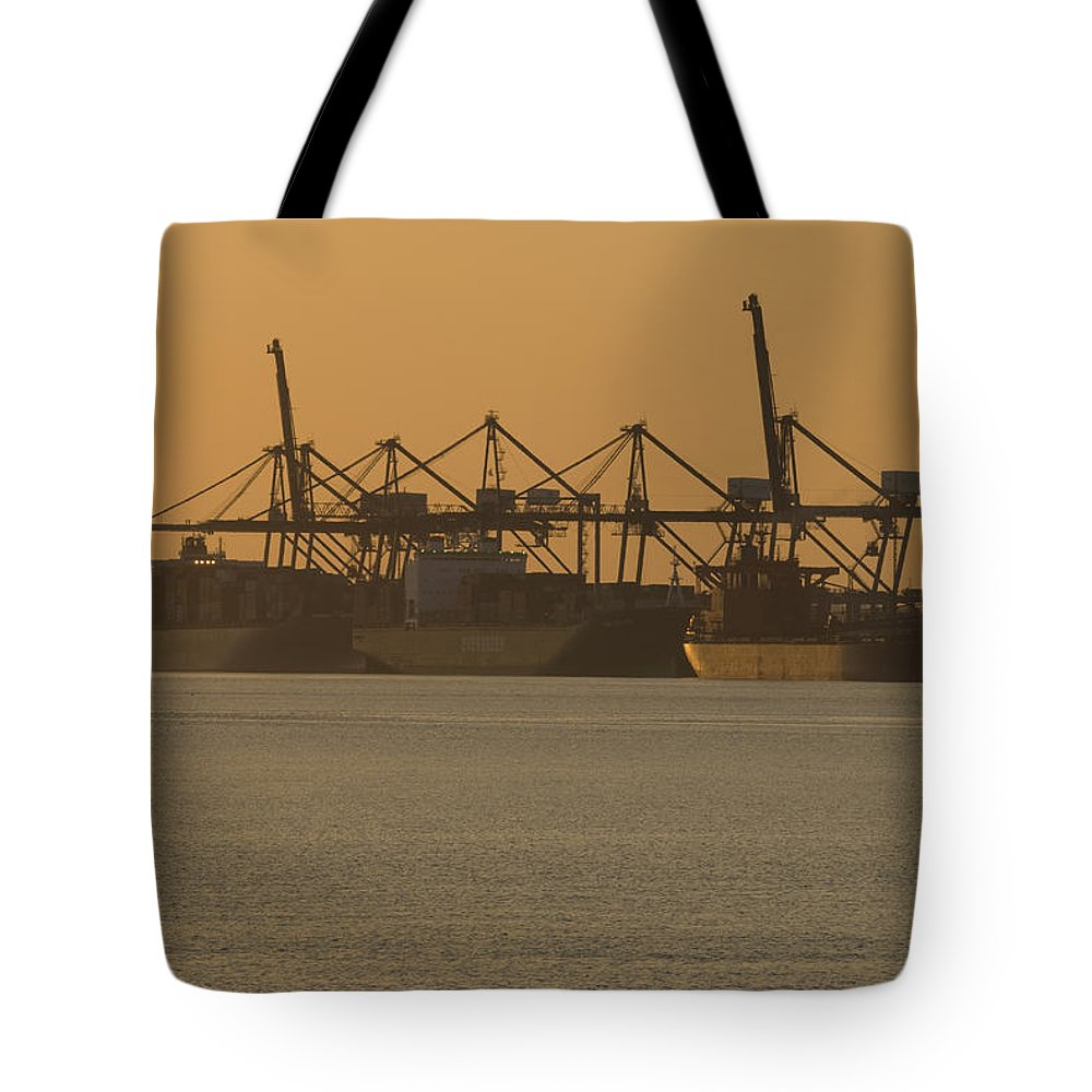 Thamesport Tote Bag featuring the photograph London Thamesport by Chris Pickett