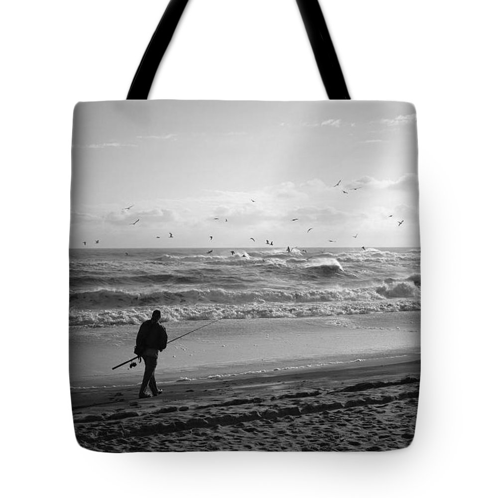 Sea Tote Bag featuring the photograph Lone Fisherman by Linda C Johnson