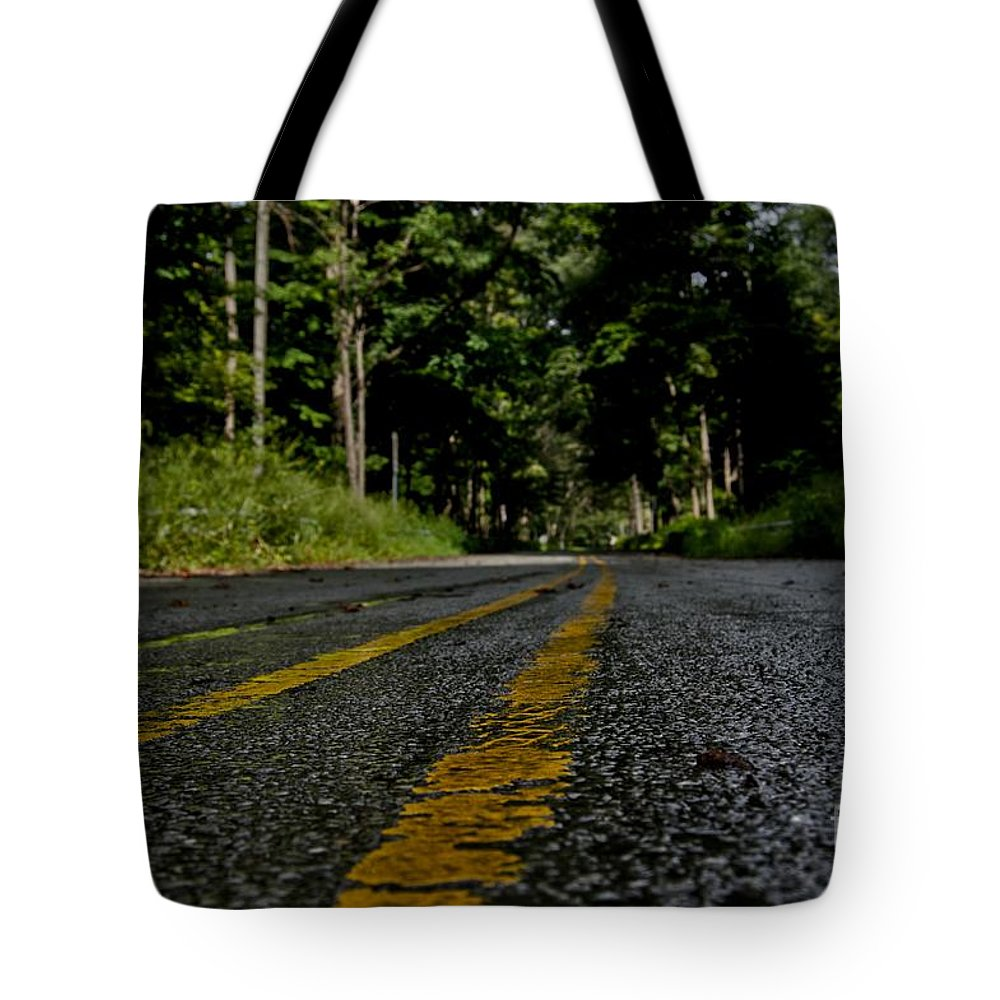 Rod Tote Bag featuring the photograph Lone Road by Jake Donaldson