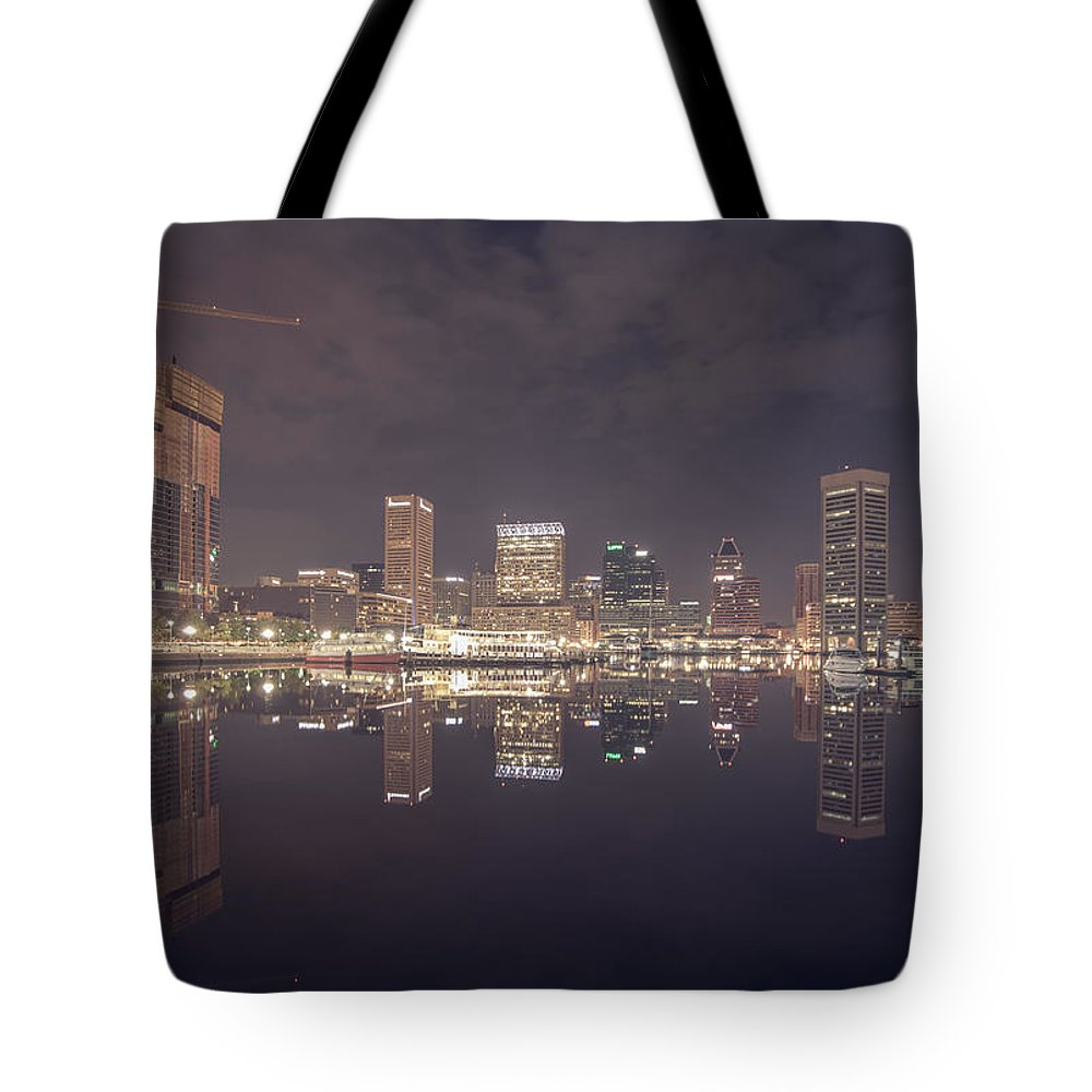 Sky Tote Bag featuring the photograph Long Exposure Of The Colorful Baltimore Skyline by Alex Grichenko