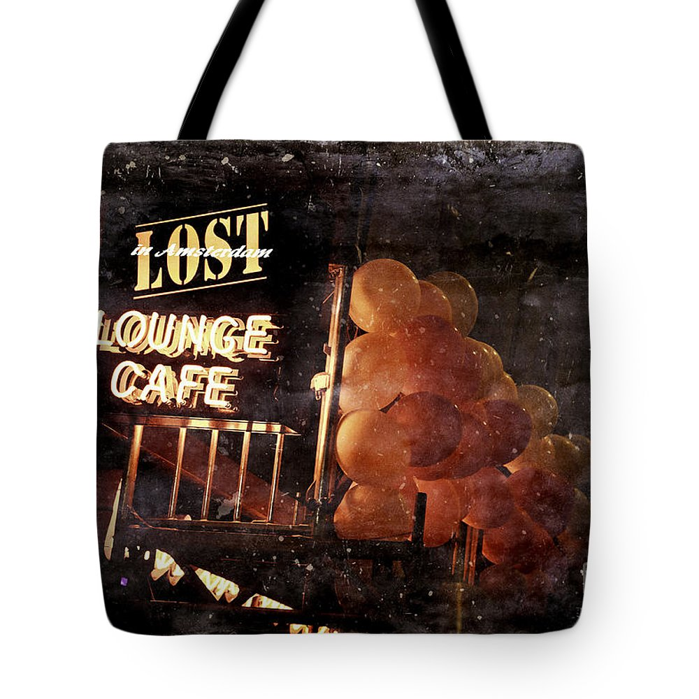Lost In Amsterdam Tote Bag featuring the photograph Lost In Amsterdam by Kamil Swiatek