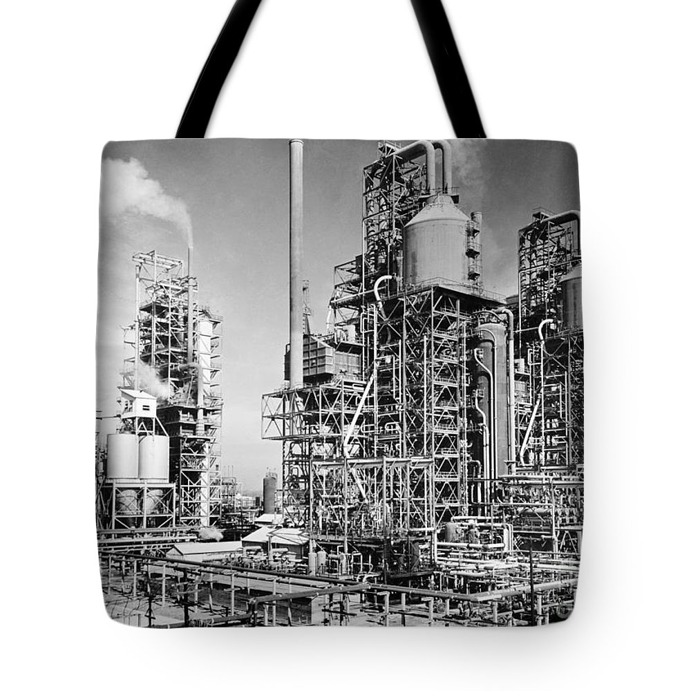 1944 Tote Bag featuring the photograph Louisiana: Oil Refinery by Granger