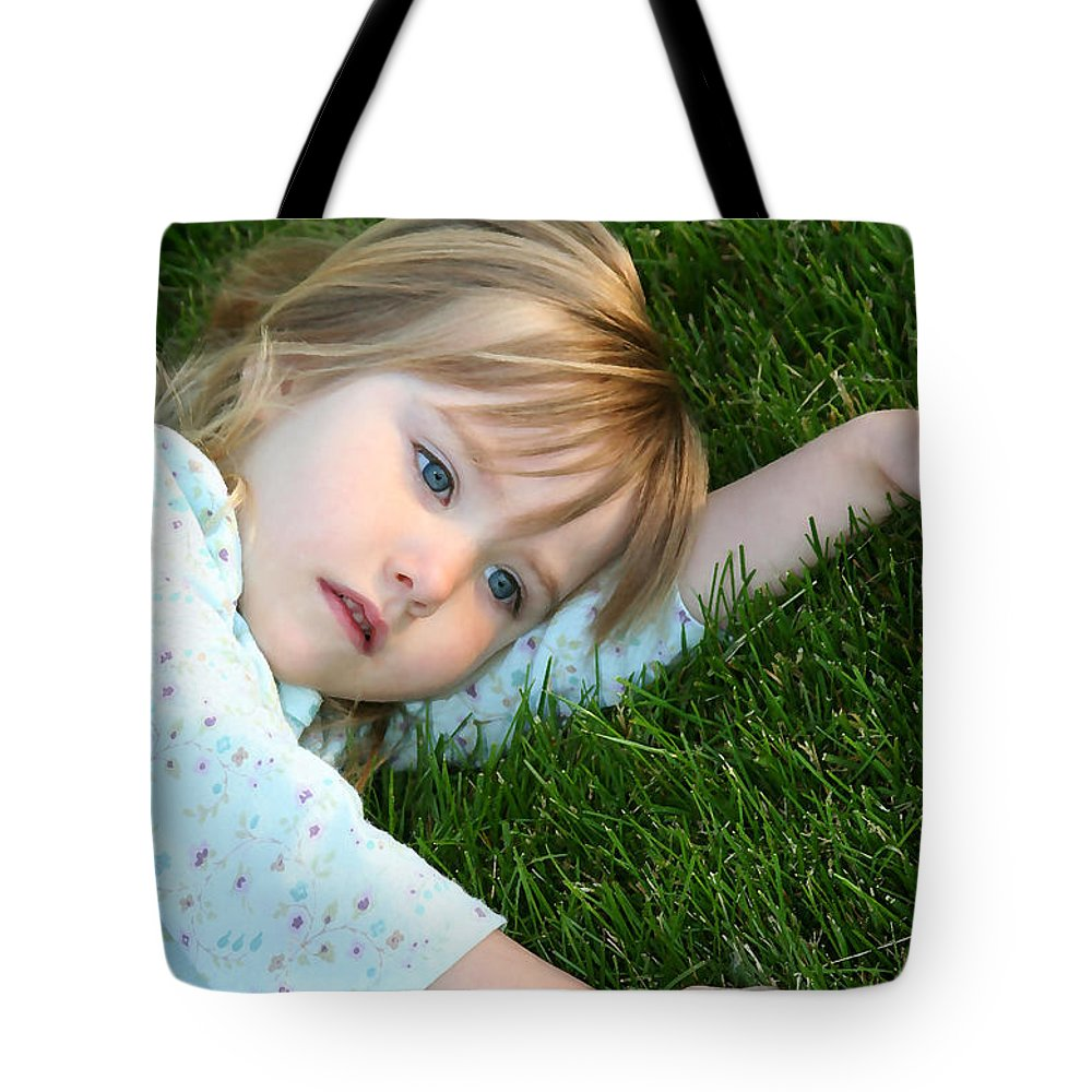 Girl Tote Bag featuring the photograph Lying In The Grass by Margie Wildblood