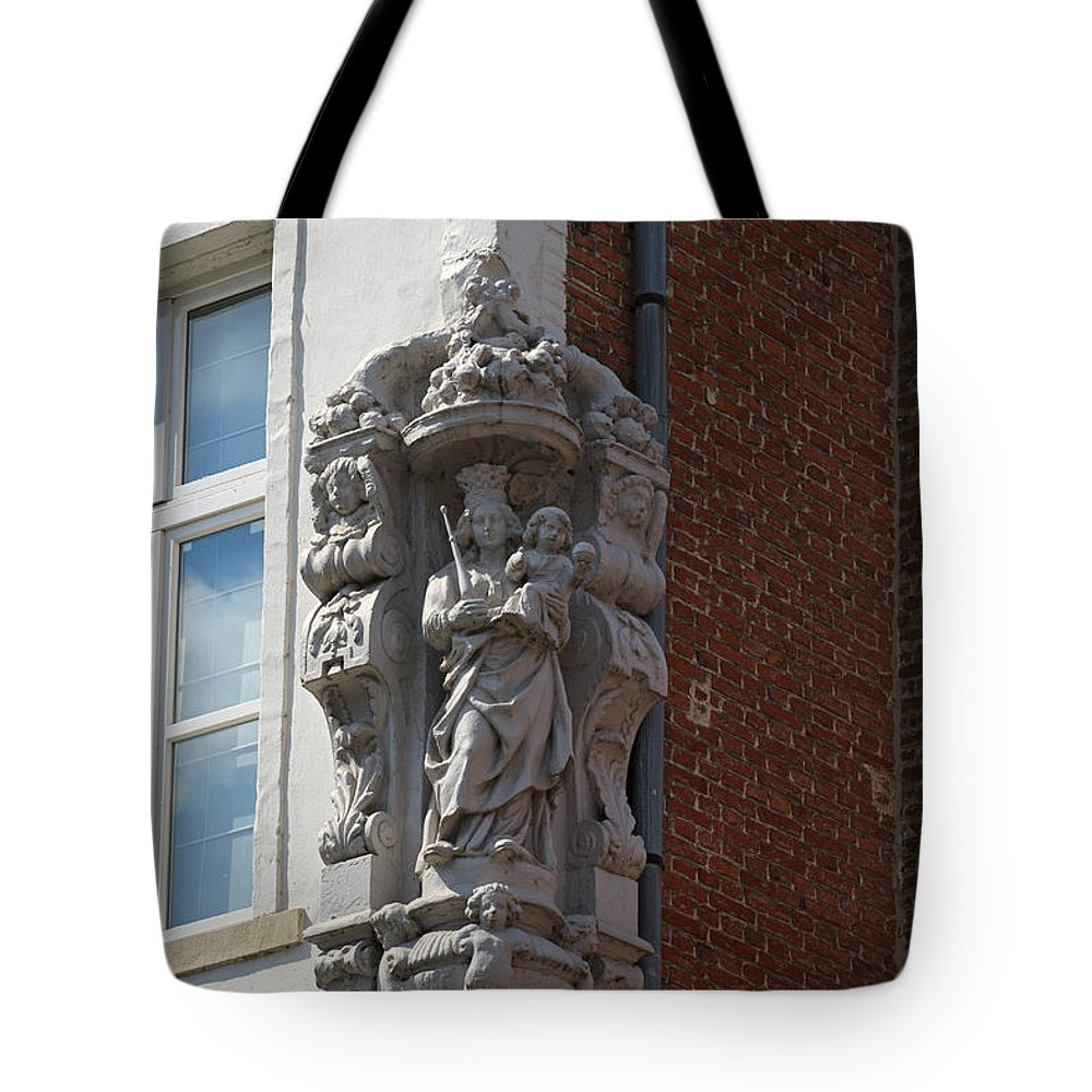 Madonna Tote Bag featuring the photograph Madonna And Child Statue On The Corner Of A House In Bruges by Louise Heusinkveld