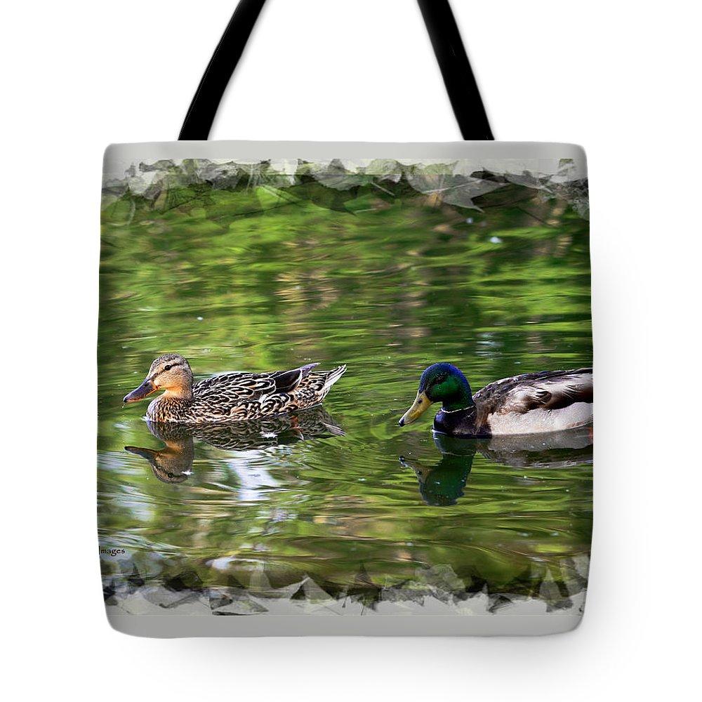 Mallards Tote Bag featuring the photograph Mallard Couple On A Pond by Kae Cheatham