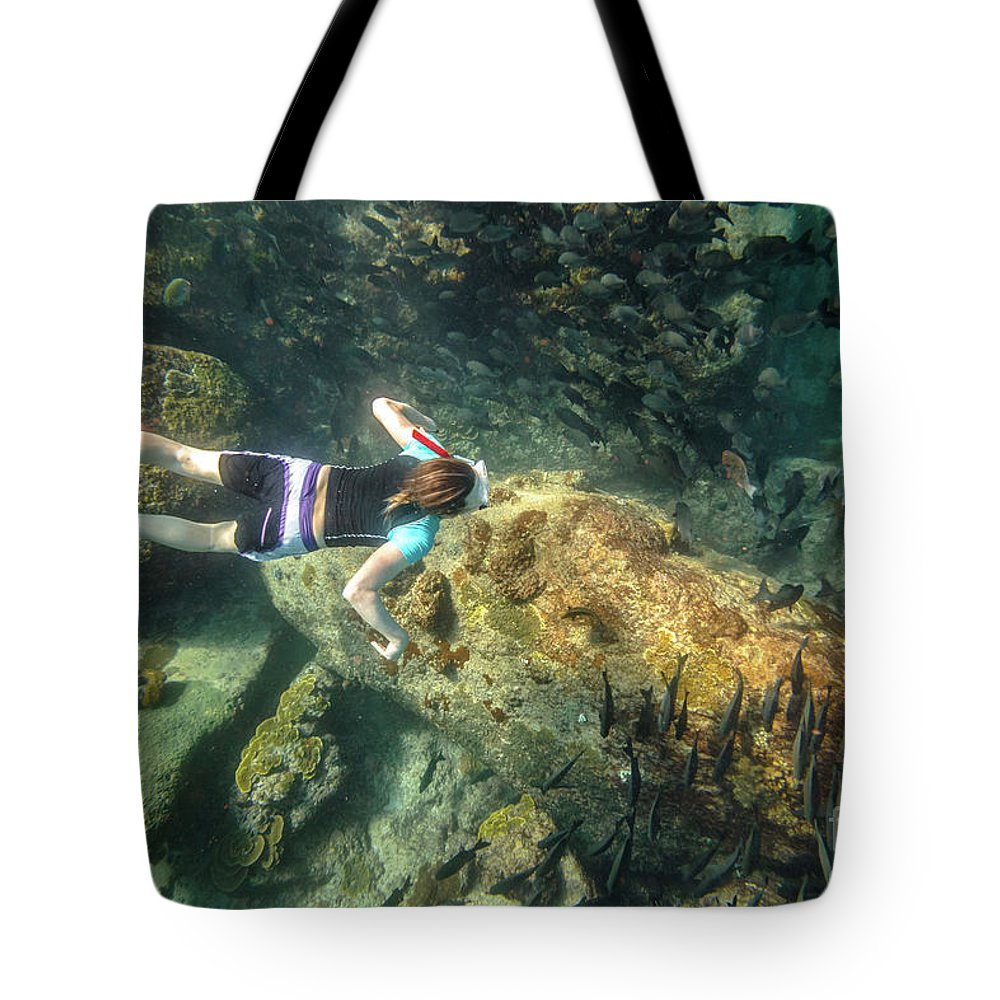 Snorkeling Tote Bag featuring the photograph Man Free Diving by Benny Marty