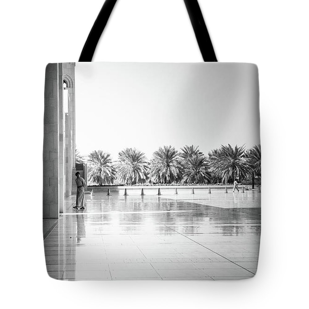 Muscat Tote Bag featuring the photograph Man From Muscat by Christoffer Karlsson