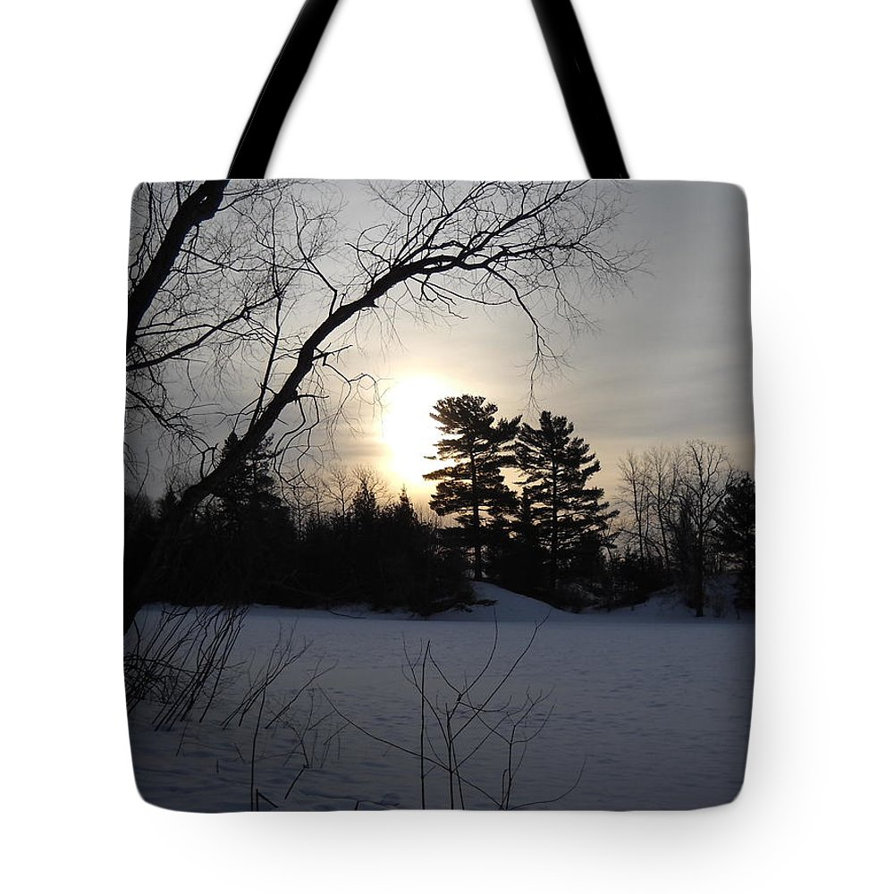 Snow Tote Bag featuring the photograph March Sunrise Behind Pines by Kent Lorentzen