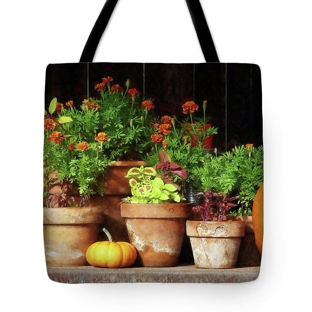 Autumn Tote Bag featuring the photograph Marigolds And Pumpkins by Susan Savad