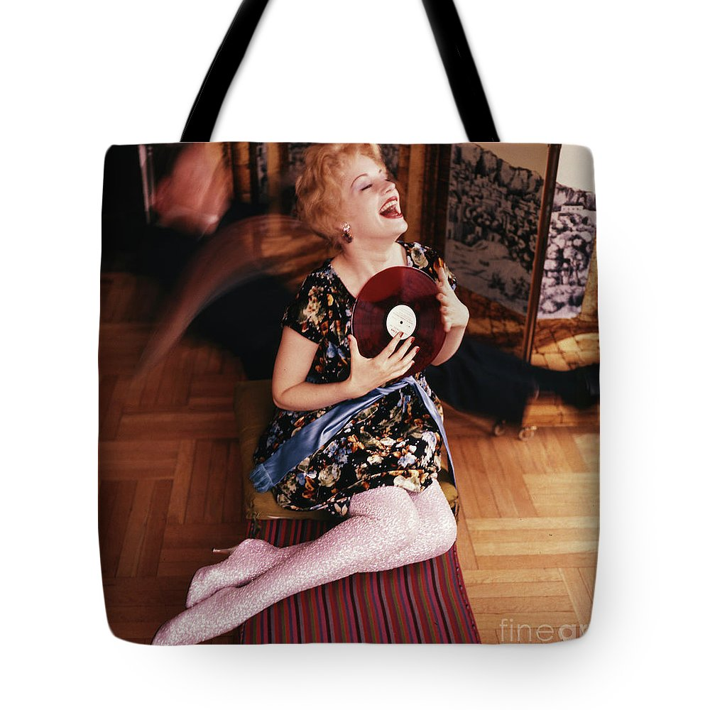 Mary Ure Tote Bag featuring the photograph Mary Ure, Actress, Holding A Vinyl Lp Recording, 1958 by The Harrington Collection