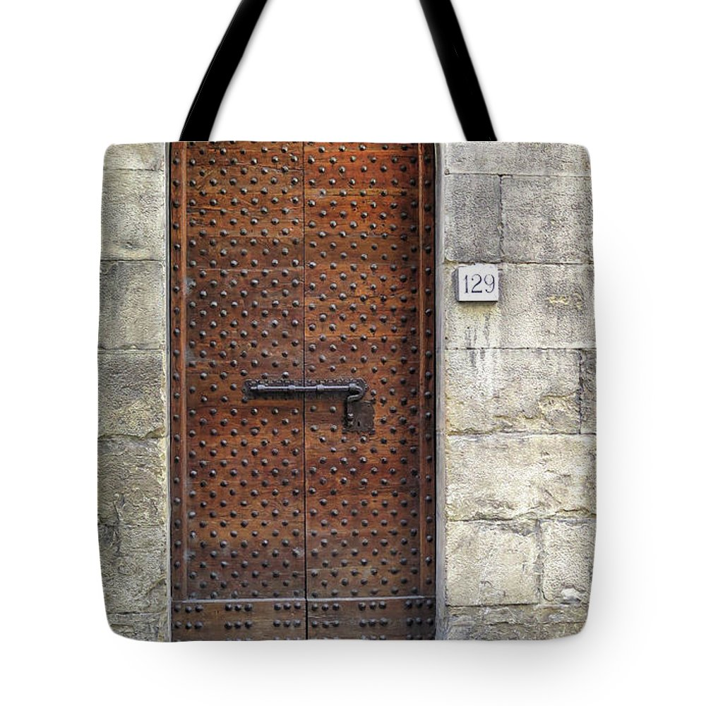 Florence Tote Bag featuring the photograph Medieval Florence Door by Dave Mills