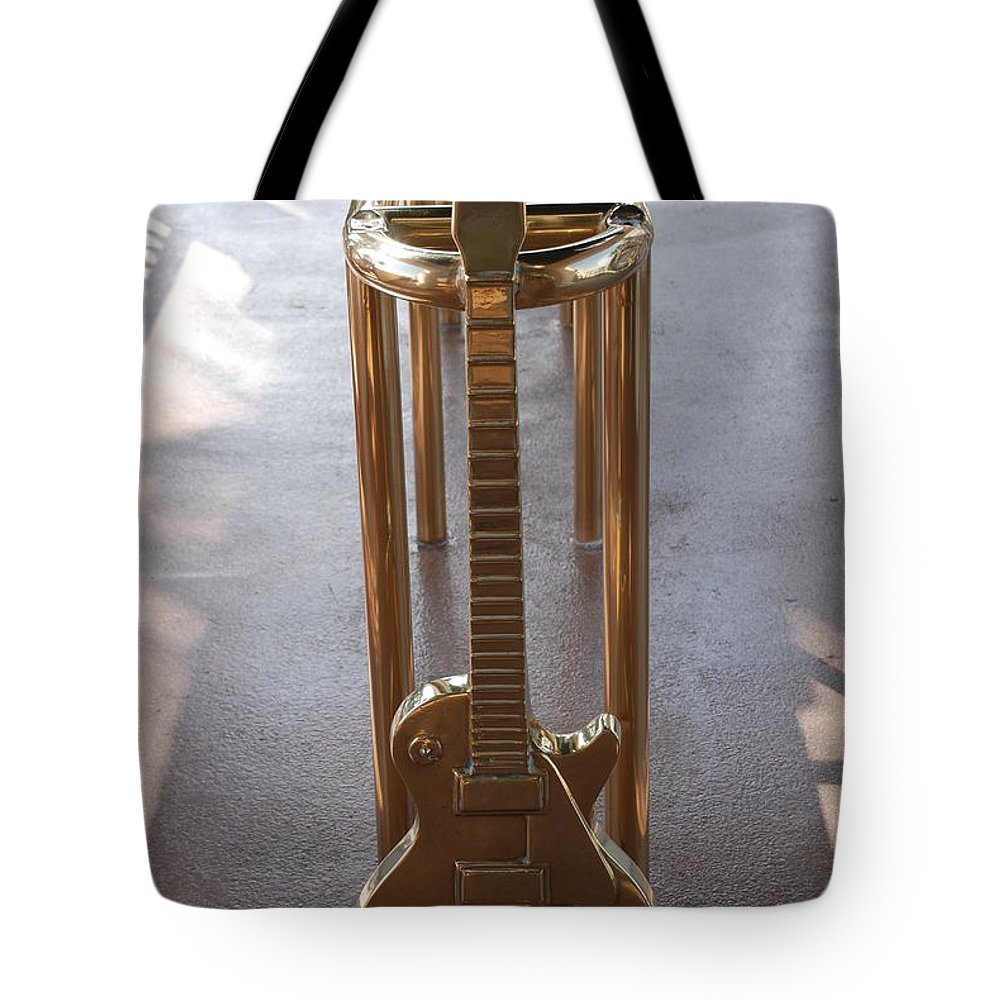 Brass Tote Bag featuring the photograph Miami Hard Rock Brass Rail by Rob Hans