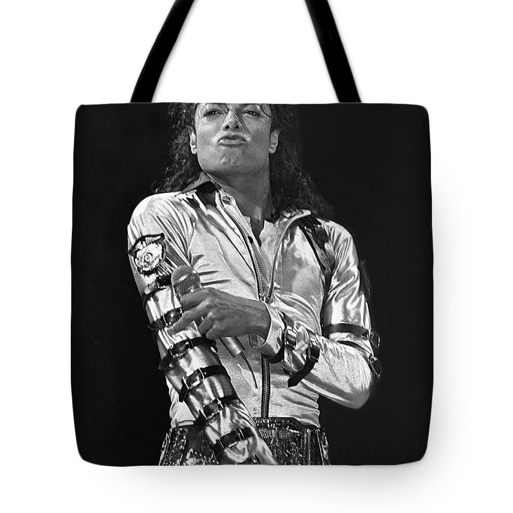 Music Legend Michael Jackson Is Shown Performing On Stage During A Live Concert Appearance Tote Bag featuring the photograph Michael Jackson - The King of Pop by Concert Photos