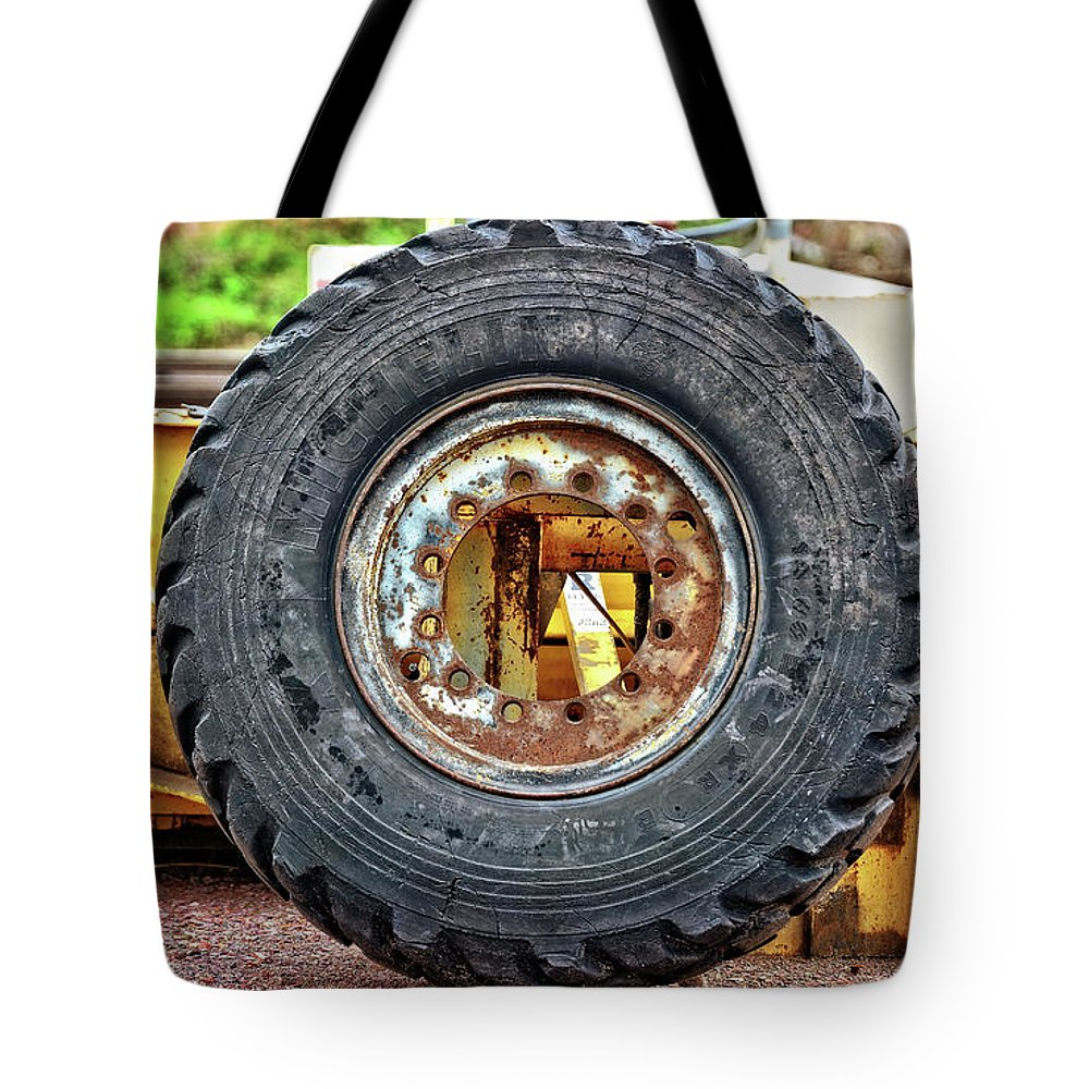 Tire Tote Bag featuring the photograph Michelin Weathered And Worn by M Dale