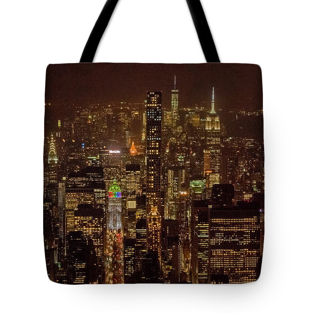 Midtown Tote Bag featuring the photograph Midtown Manhattan Skyline Aerial At Night by David Oppenheimer