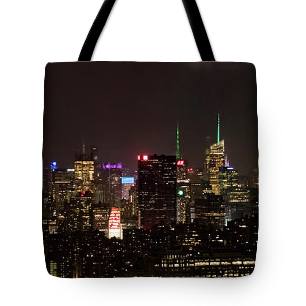 Midtown Tote Bag featuring the photograph Midtown West Manhattan Skyline Aerial At Night by David Oppenheimer