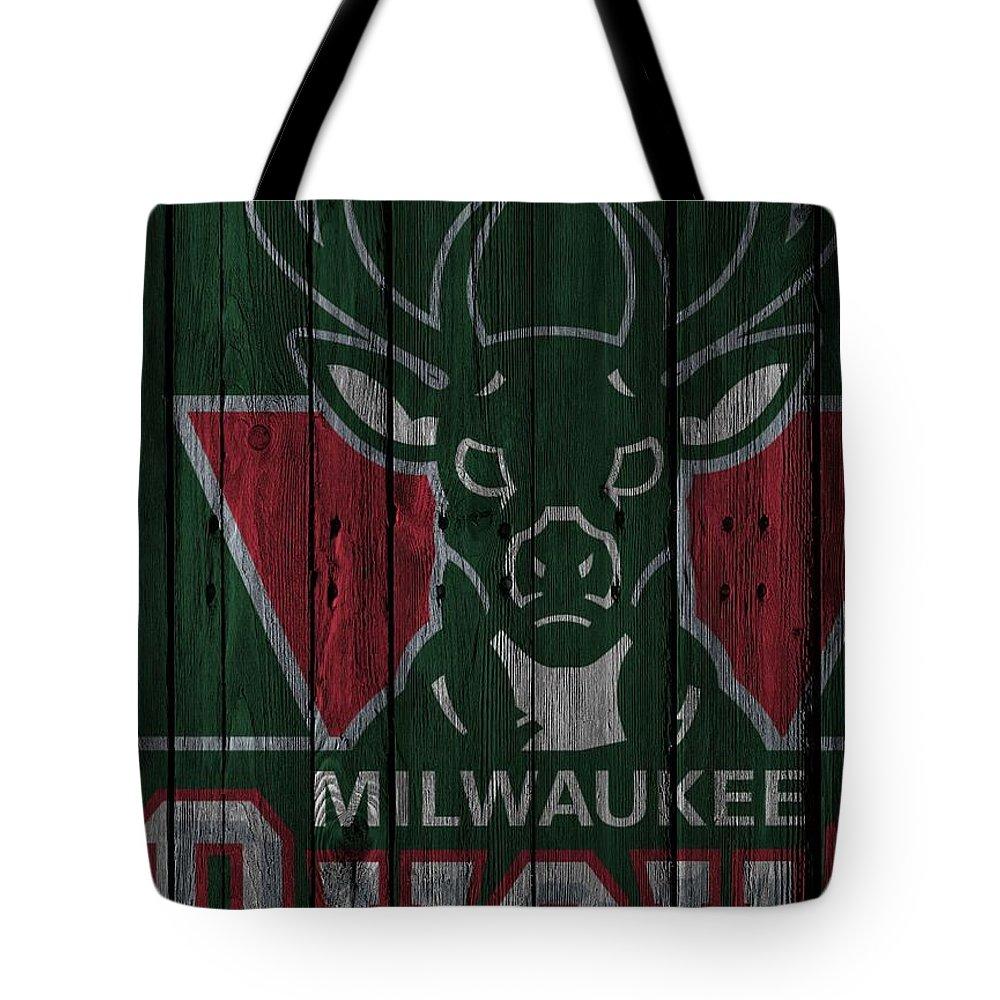 Bucks Tote Bag featuring the photograph Milwaukee Bucks Wood Fence by Joe Hamilton