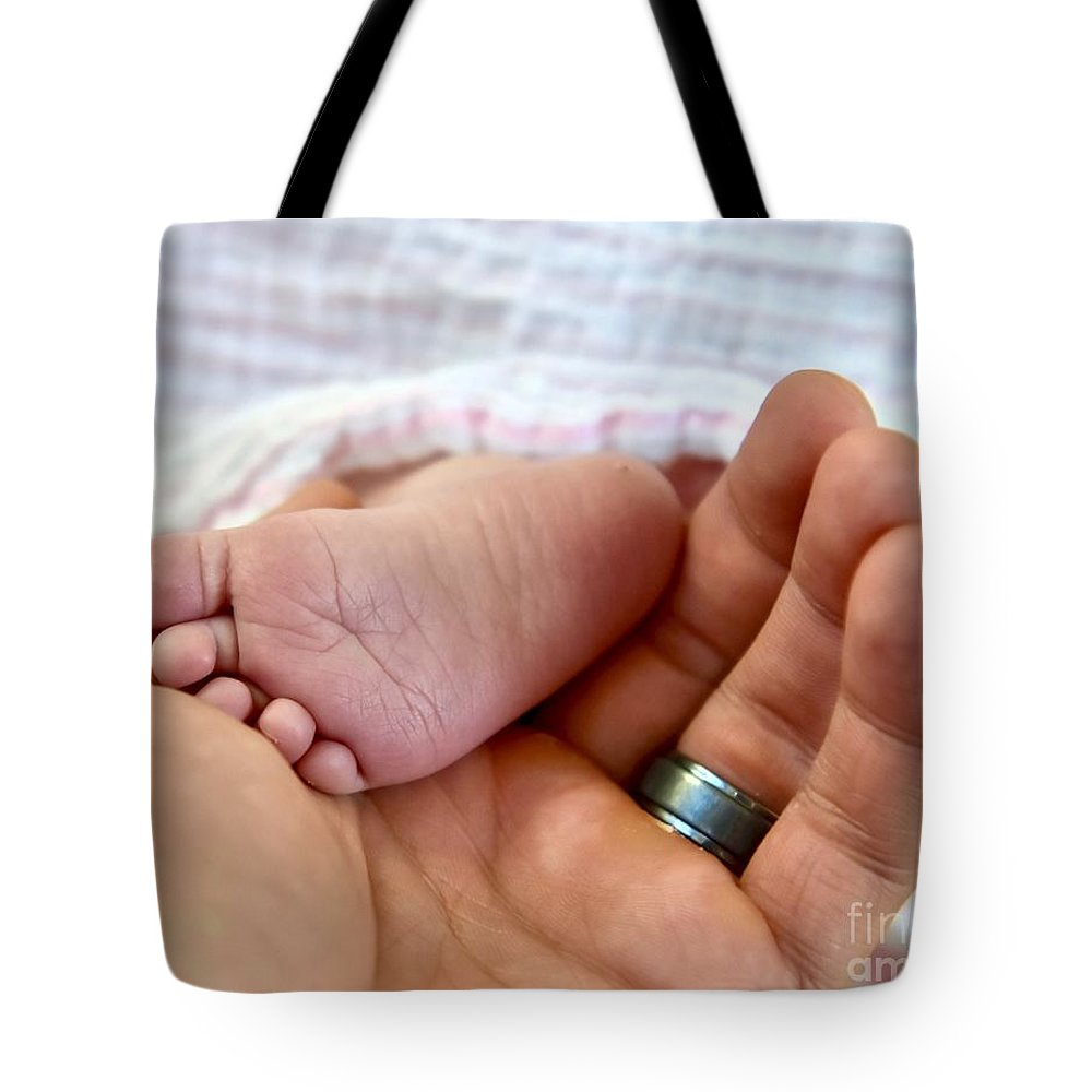 Babies Feet Tote Bag featuring the photograph Miracles by Jeramey Lende