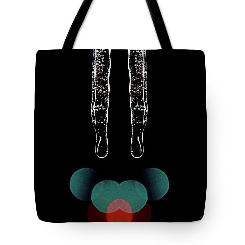 Icicles Tote Bag featuring the photograph Mirror Icicles Red And Green Bokah by Andee Design
