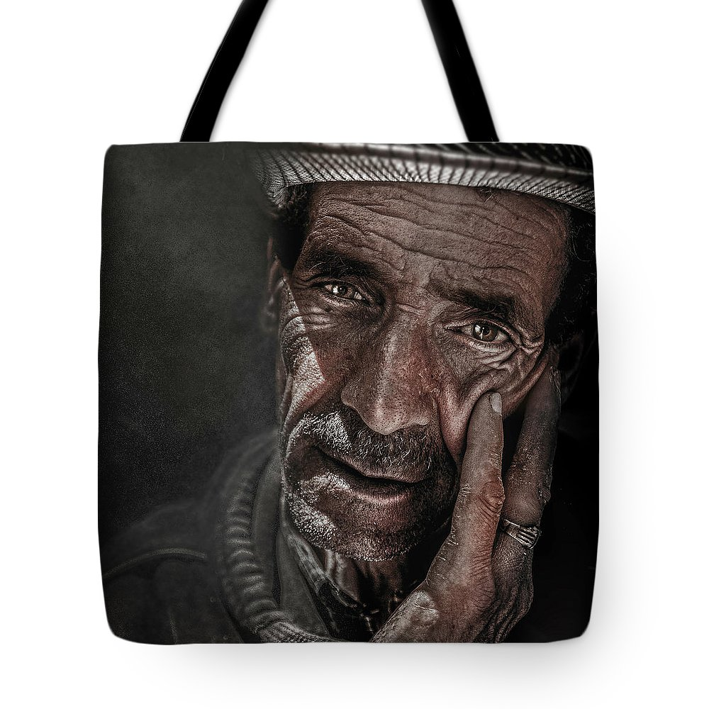 Man Tote Bag featuring the photograph Miserable Life by Zouhir Elmessaoudi