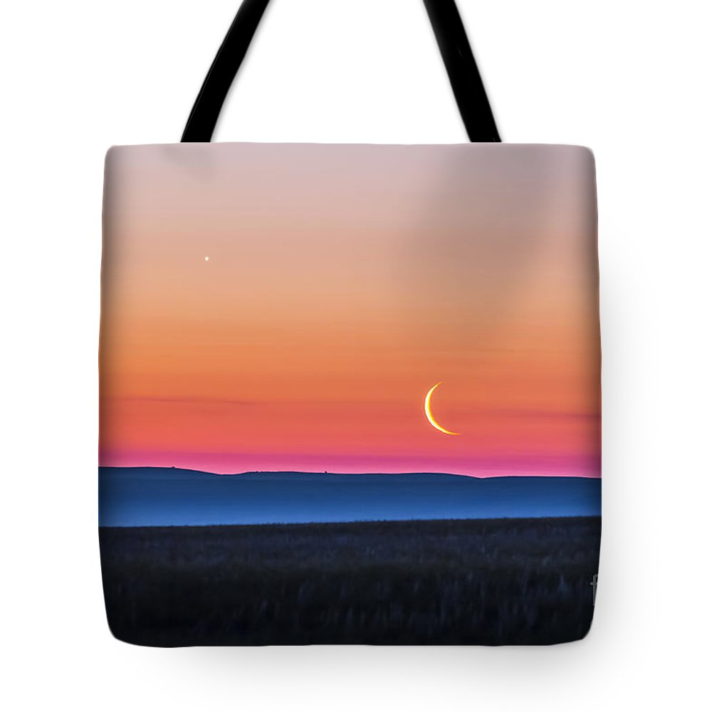 Alberta Tote Bag featuring the photograph Moon And Venus Rising Over The Flat by Alan Dyer