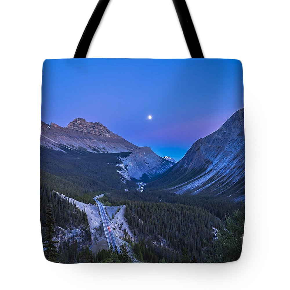 Banff National Park Tote Bag featuring the photograph Moon Over Icefields Parkway In Alberta by Alan Dyer