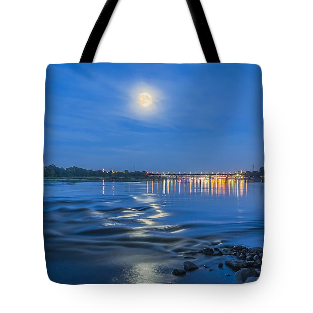 Moonlight Tote Bag featuring the photograph Moon Over Vistula River In Warsaw by Julis Simo