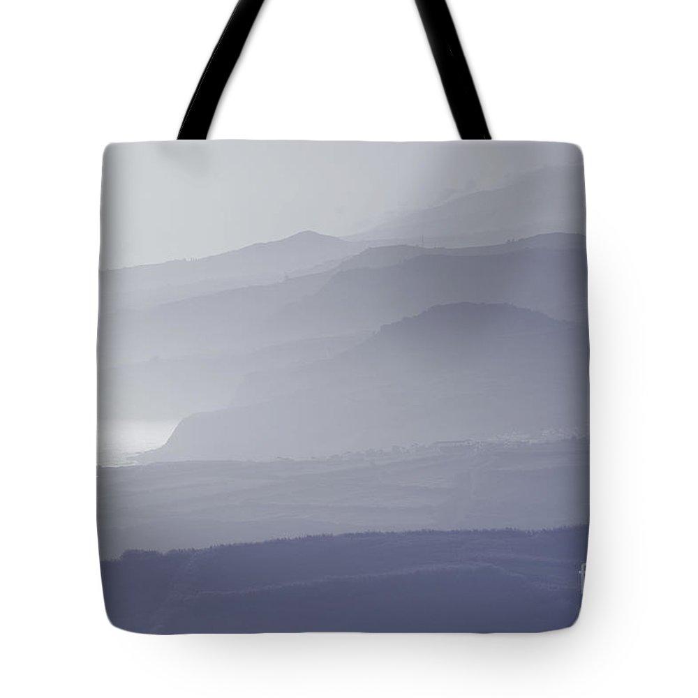 Coastline Tote Bag featuring the photograph Morning Mist by Gaspar Avila