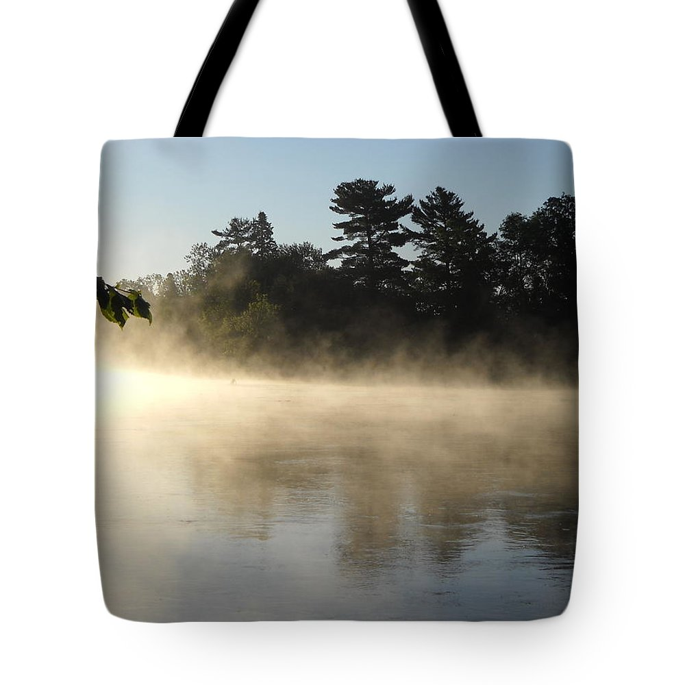 Mist Tote Bag featuring the photograph Morning Mist Glowing In Sunlight by Kent Lorentzen
