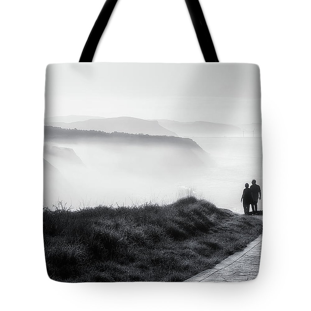 Walk Tote Bag featuring the photograph Morning Walk With Sea Mist by Mikel Martinez de Osaba