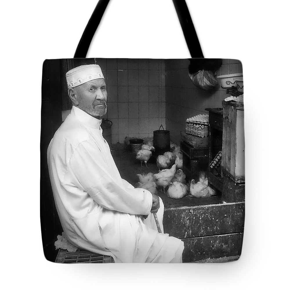 Shopkeeper Tote Bag featuring the photograph Moroccan Shopkeeper by Ed Tepper