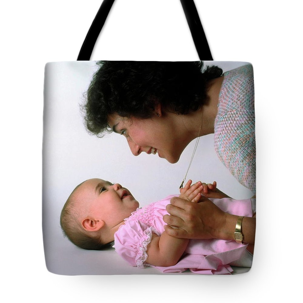 Mother Tote Bag featuring the photograph Mother And Baby Girl Smiling by Sally Weigand