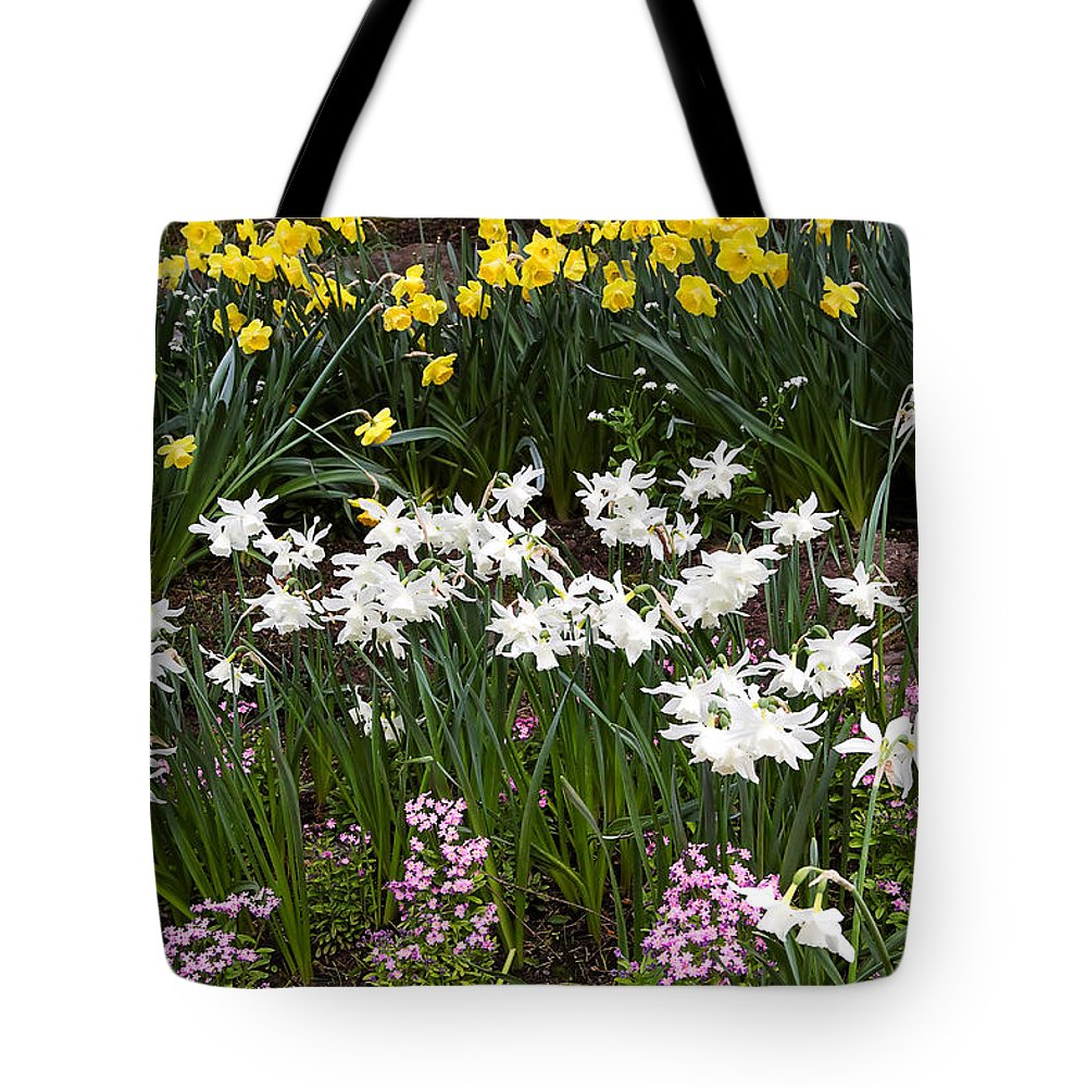 Flower Tote Bag featuring the photograph Narcissus And Daffodils In A Spring Flowerbed by Louise Heusinkveld