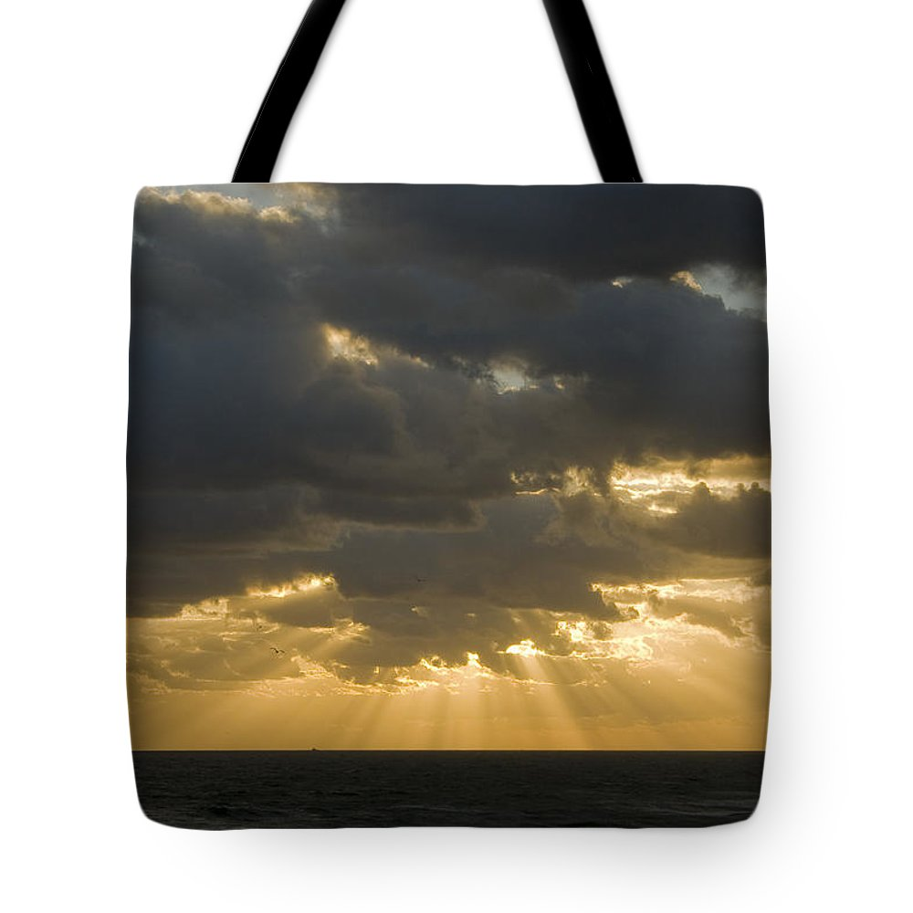 Ocean Sunset Sun Cloud Clouds Ray Rays Beam Beams Bright Wave Waves Water Sea Beach Golden Nature Tote Bag featuring the photograph New Beginning by Andrei Shliakhau