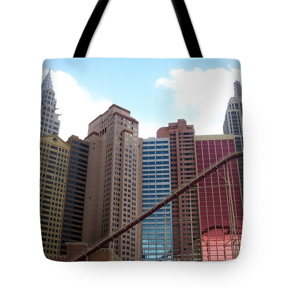Vegas Tote Bag featuring the photograph New York Hotel With Clouds by Anita Burgermeister