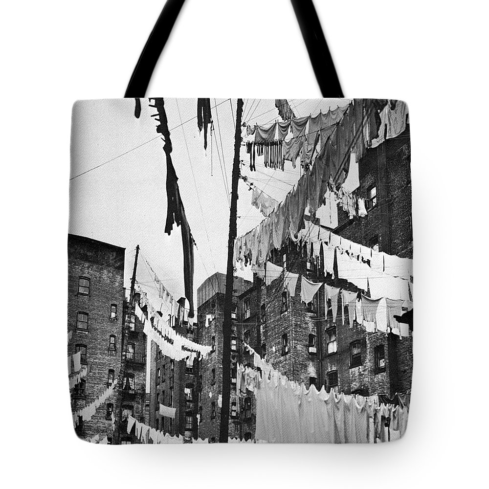 1936 Tote Bag featuring the photograph New York: Tenement, 1936 by Granger